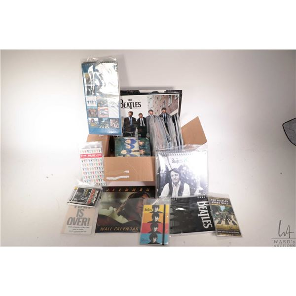 Large selection of Beatles or Beatles related calendars in assorted styles and years plus a note boo