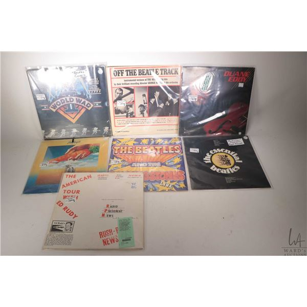 """Seven assorted LPs including """"The American Tour with Ed Rudy"""", """" The Essential Beatles"""" ( made in Au"""