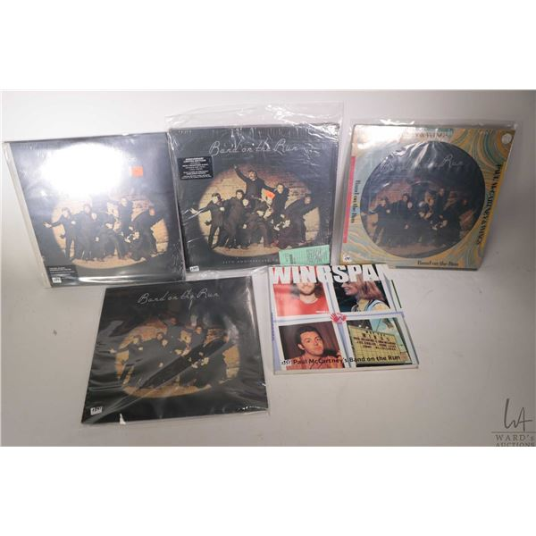 """Four LPs all version of Paul McCartney and Wings """"Band On the Run"""" including black vinyl made by MPL"""