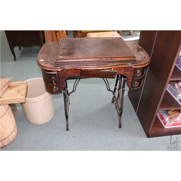 Kenmore electric sewing machine in an oak sewing cabinet, includes accessories but needs to be rewir