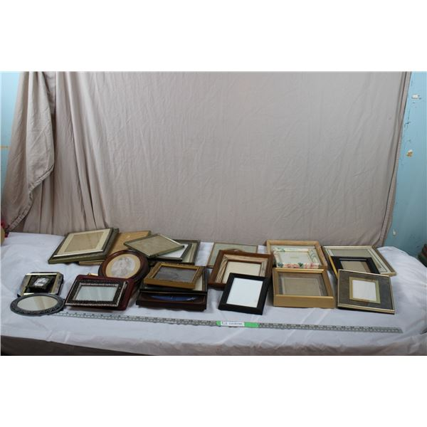Box of various sized picture frames
