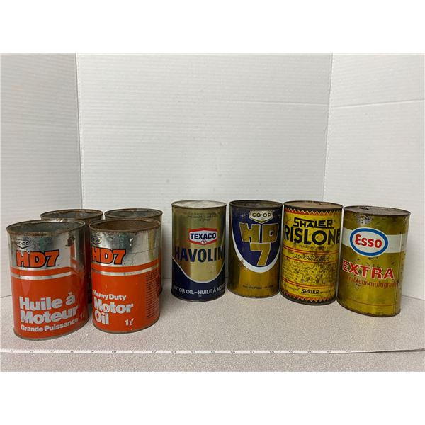 8 empty oil cans