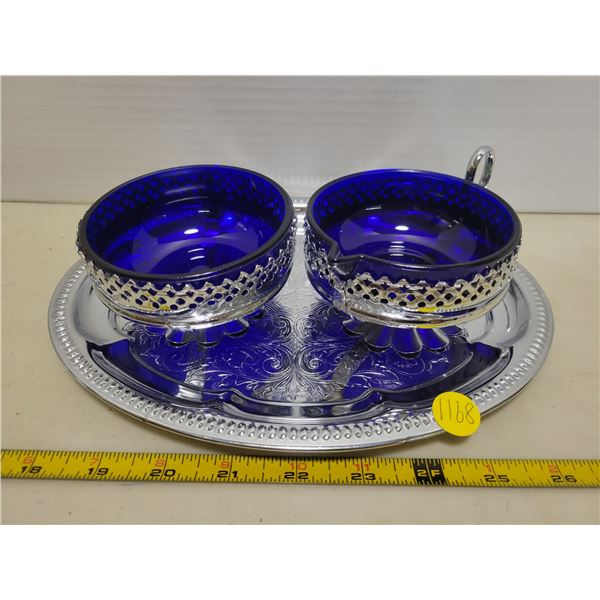 Silver & blue cream and sugar bowls on a tray