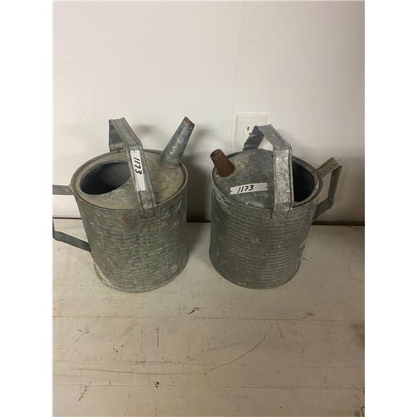 2 metal watering cans