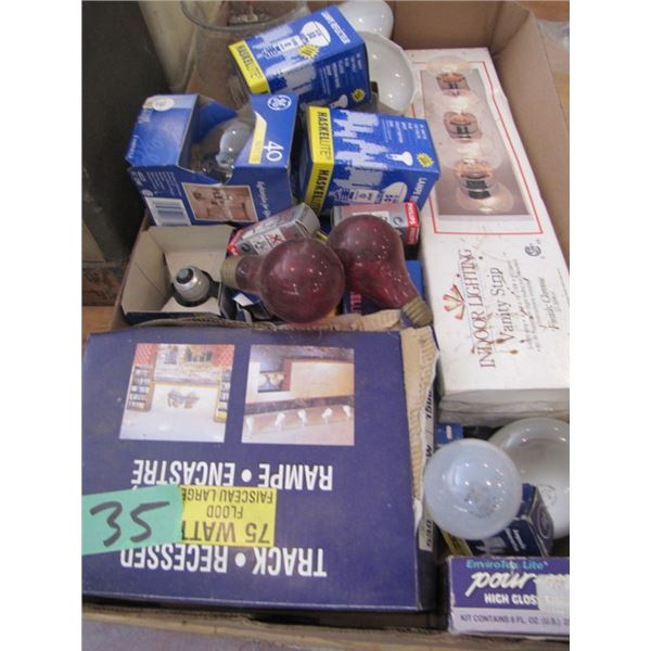 box with assorted light bulbs and vanity strip