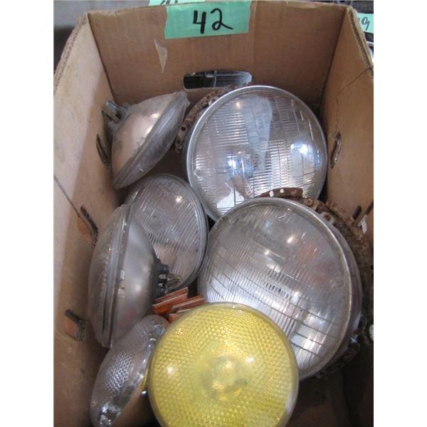 box of assorted headlights