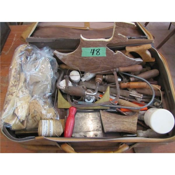 suitcase with carving supplies