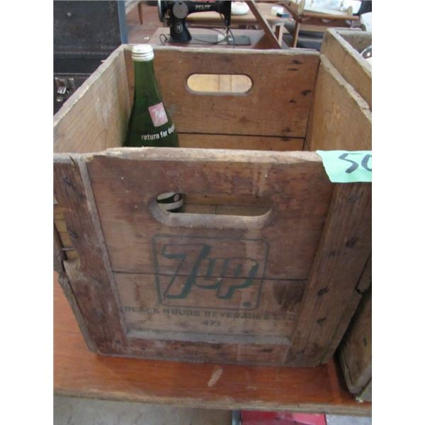 wooden 7up crate with one 7up bottle
