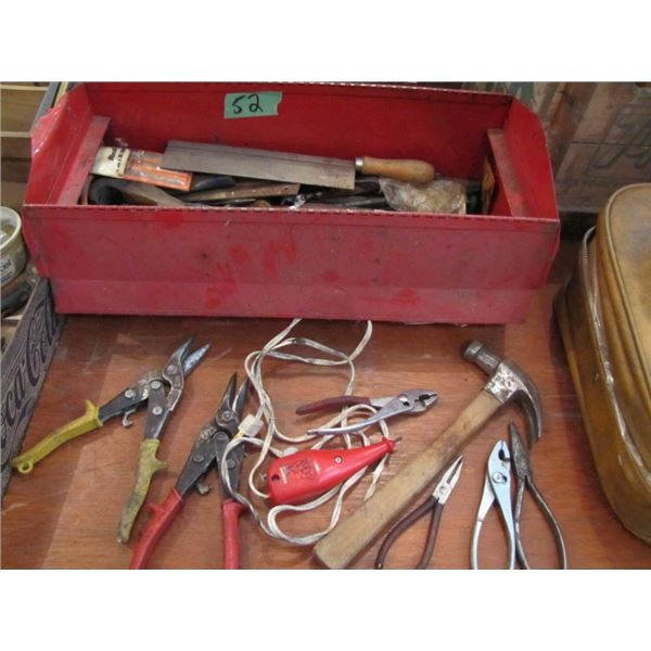 red metal toolbox with tinsnips, pliers, hammers and other tools