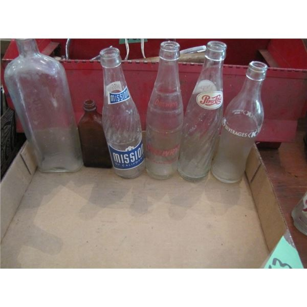 box with pop bottles