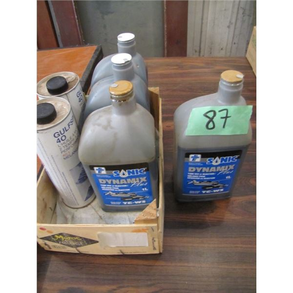 lot of two cycle engine oil - a couple seem to have leaked