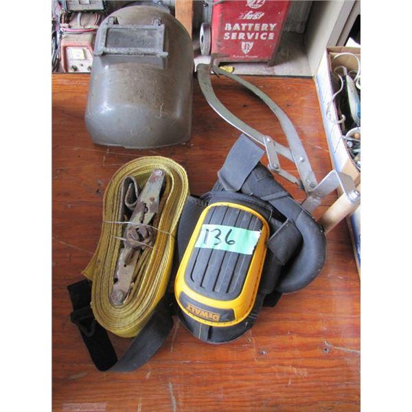 ice tongs, welding helmet, tie down strap, knee pads
