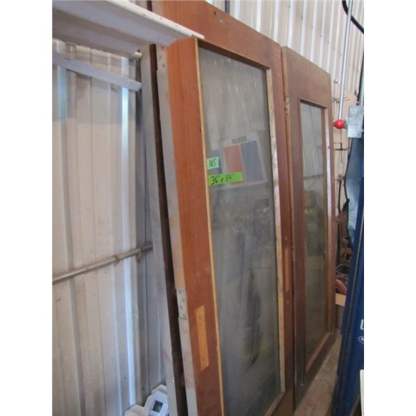 """lot of four wood framed doors - 36"""" by 84"""", 1 3/4"""" thick- 3 have the glass in them"""
