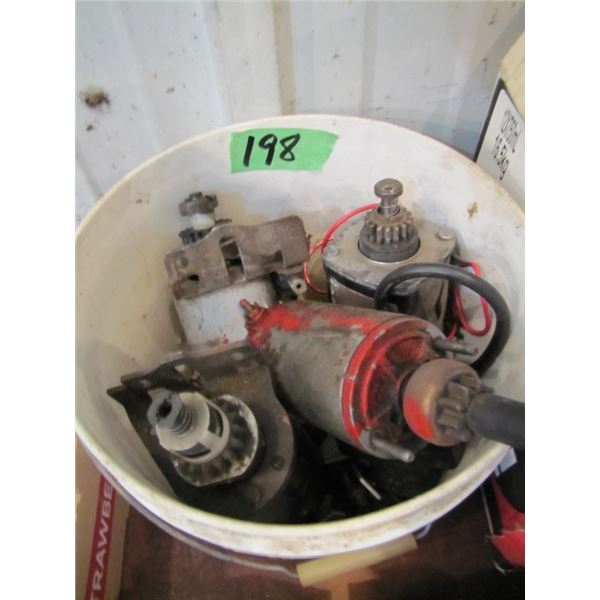 pail with assorted small engine starters