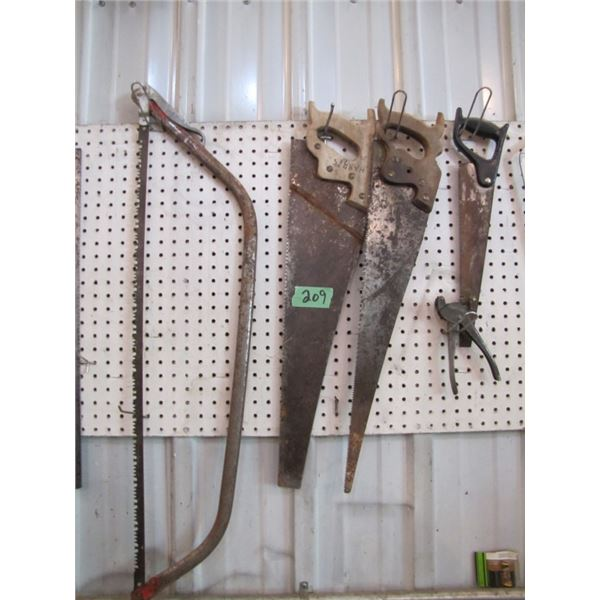 lot of hand saws and saw set