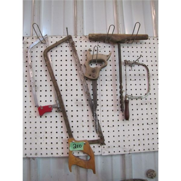 lot with 2 hand meat saws, coping saw old drill auger
