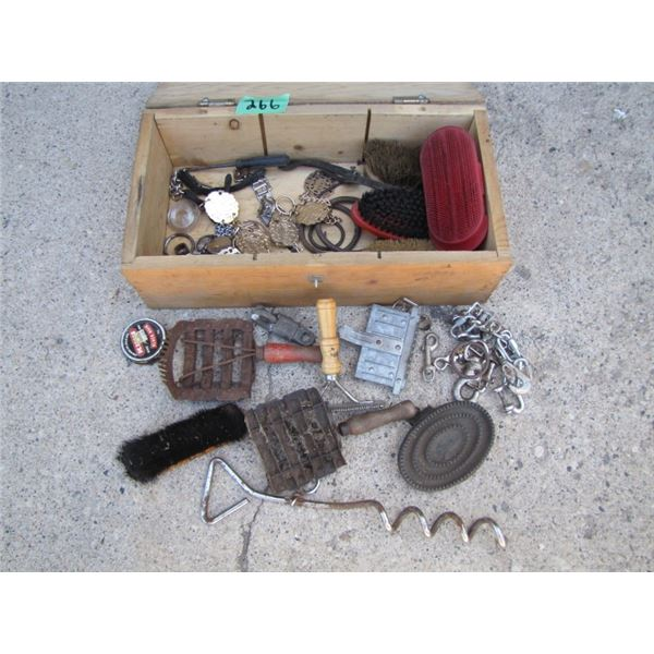 wood box with curry combs etcetera