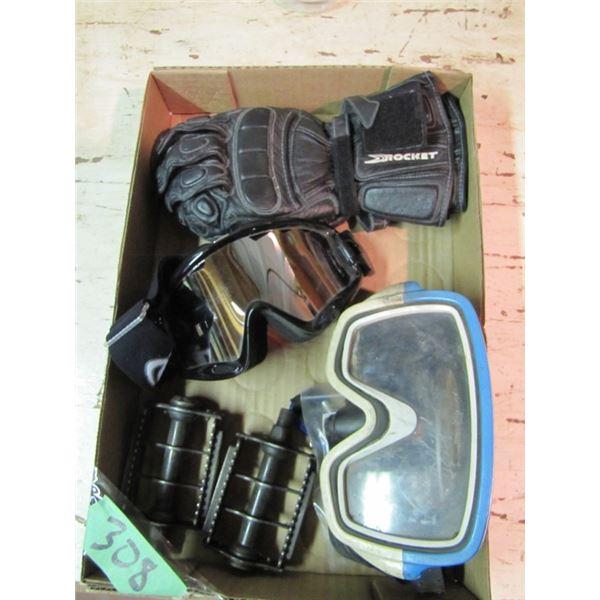 box with bike pedals, swim goggles, bike goggles and gloves