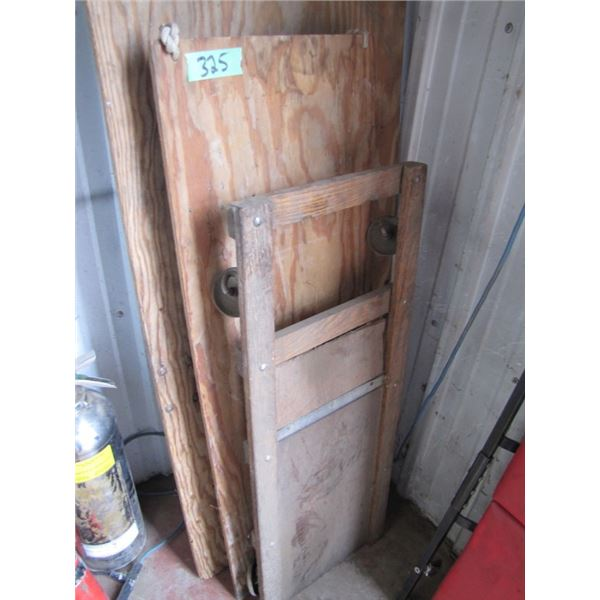lot with 2 rolling movers and one wood shop creeper