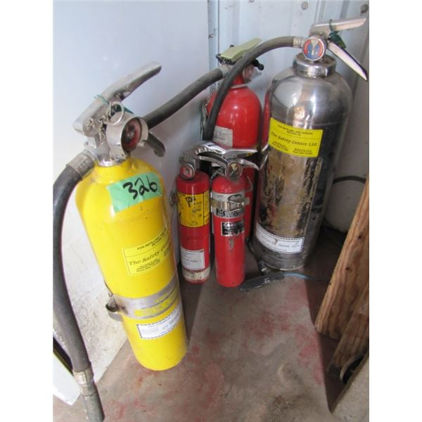 lot of five fire extinguishers - the chrome one is the only one that is charged