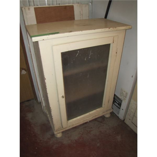 small cabinet painted white with frosted glass door- missing right rear leg