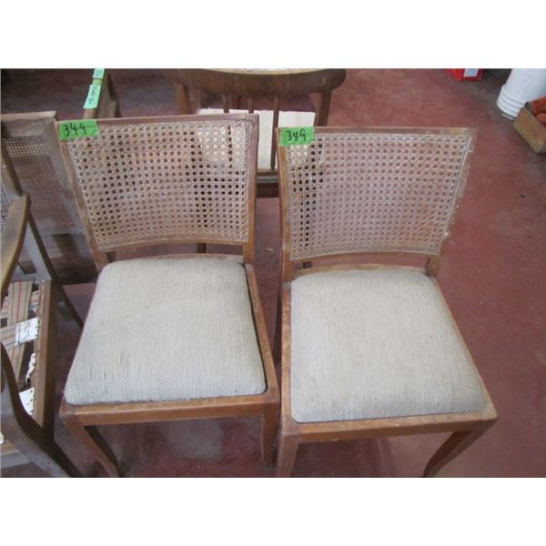 lot of two wicker back wood frame chairs