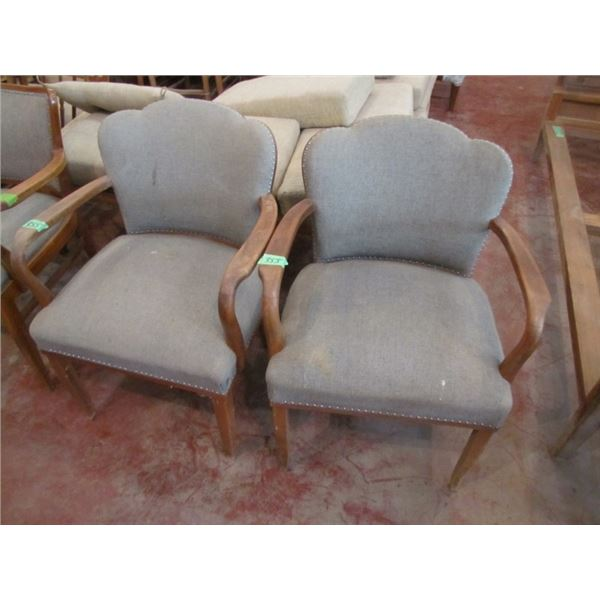 two shell back upholstered chairs