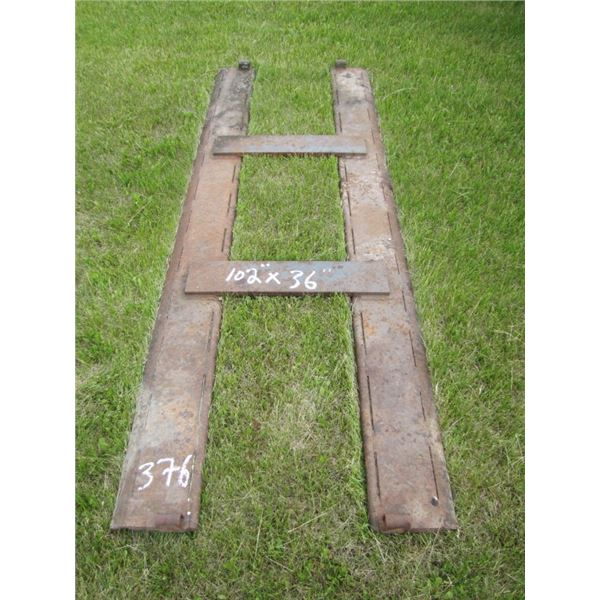 metal lift from elevator driveway for lifting wagons and trucks to dump