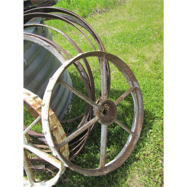 lot of two metal wheels and 5 wagon wheel rims