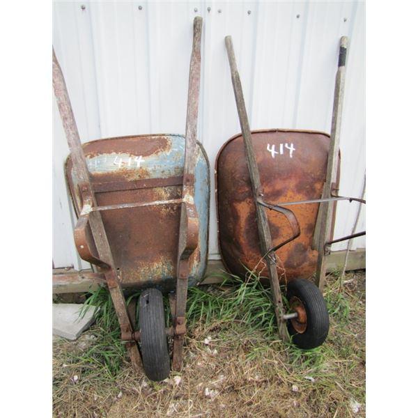 lot of two wheel barrels