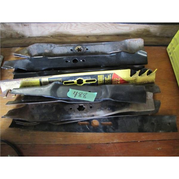 lot of new and used lawn mower blades