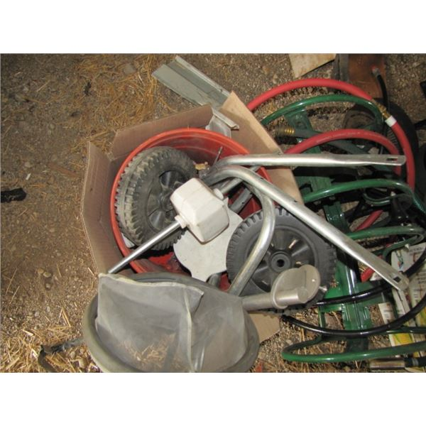 lot with soaker hose, tomato cages, hose reel, seed spreader - needs to be assembled