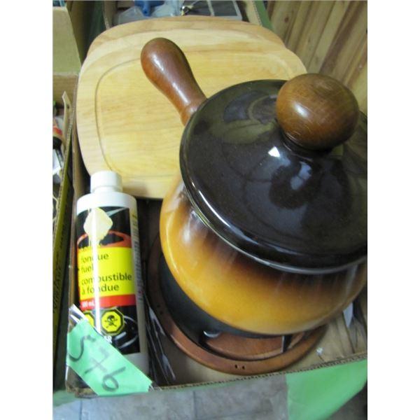 fondue pot and cutting boards