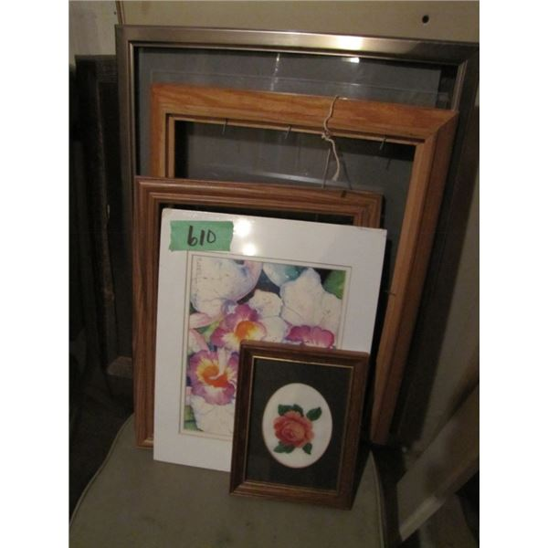 assorted picture frames and pictures