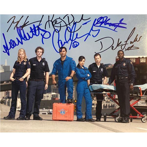 Trauma cast signed photo