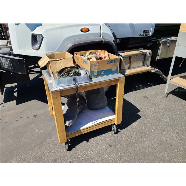 2 TIER MOBILE WOOD WORK TABLE WITH 3 BOXES AND 2 BAG OF ASSORTED STRAPS AND RATCHET TIE DOWNS