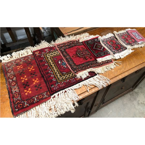 Group of 7 very small hand-knotted Persian rugs
