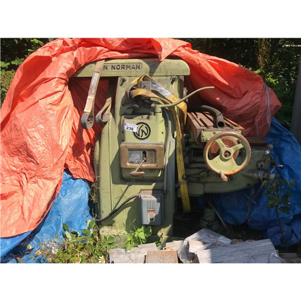 VAN NORMAN MILLING MACHINE. HAS BEEN STORED OUTSIDE UNDER TARPS. CONDITION UNKNOWN. HAS RUST.