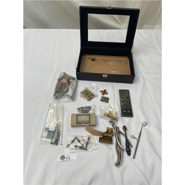Small Display Case filled with Dental Instruments