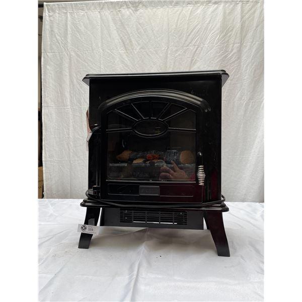 Plug In Decorative Fire Place Emits Heat