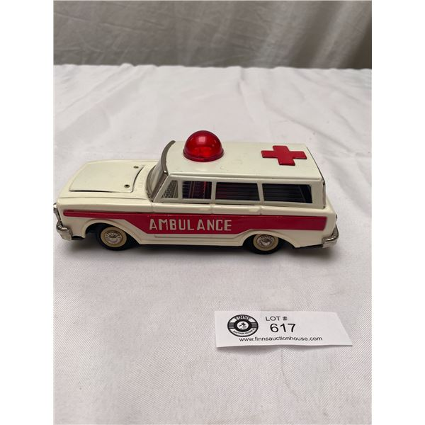 1960's Tin Ambulance with Siren Friction Toy. Hood Opens