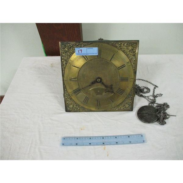 Very old brass clock face