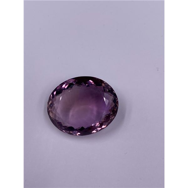 HUGE AMETHYST 50.29CT, 27.69 X 22.65 X 12.12MM, OVAL CUT, LOUPE CLEAN, BOLIVA, UNTREATED