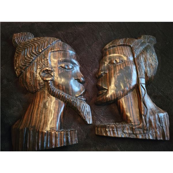 carved wooden heads