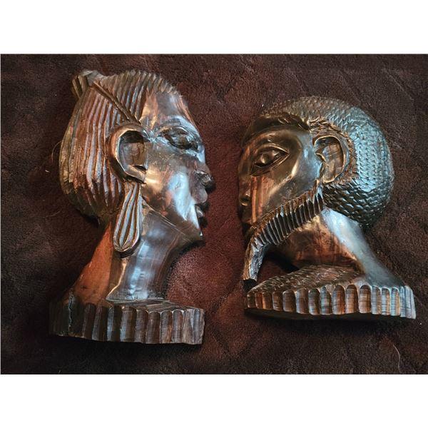 Carved wooden heads (one broken)