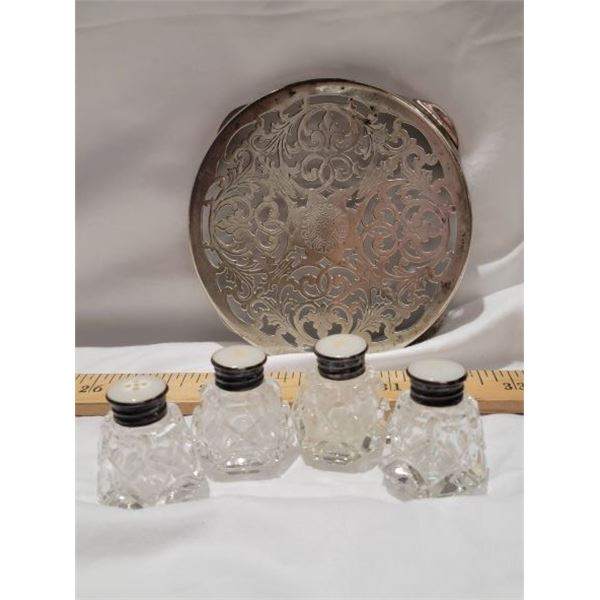 lot sterling shakers and trivet