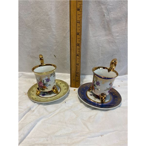 Two footed cups and saucers