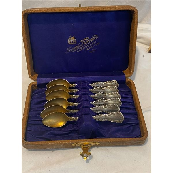 Sterling spoons in case