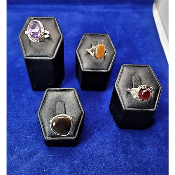 8)  LOT OF 4 FASHION RINGS, INCLUDING:  AMETHYST,