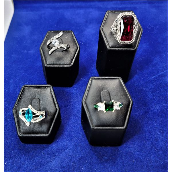 9)  LOT OF 4 FASHION RINGS, INCLUDES; CZ COLORS